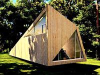 Интересный дизайн дома треуголной формы